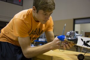 Student working on air plane in Engineering