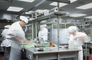 Close up of students in the kitchen