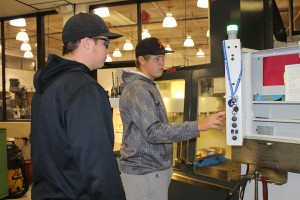 Student working on CNC machine