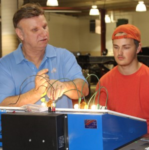 Instructor and student working on lighting in electrical technology