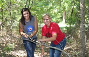 Two female students doing community service