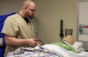 Nursing student and manikin
