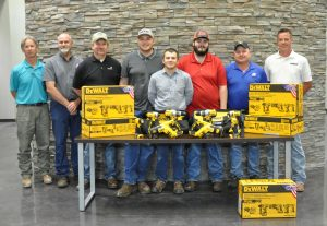 Adult Team Works Team with Instructors and DeWalt Tools