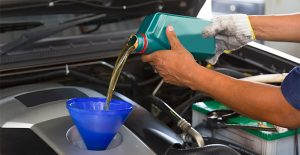 Pouring oil into a car